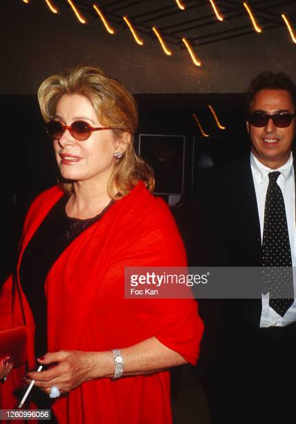Catherine Deneuve and Gilles Dufour attend the 55th Cannes Film Festival in May 2002, in Cannes, France.
