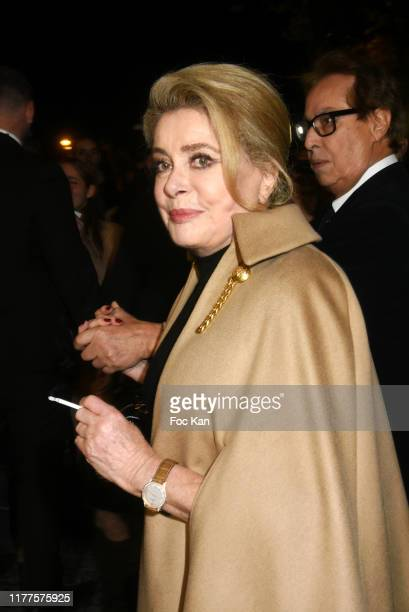 Catherine Deneuve and Gilles Dufour attend the Celine Womenswear Spring/Summer 2020 show as part of Paris Fashion Week on September 27, 2019 in...