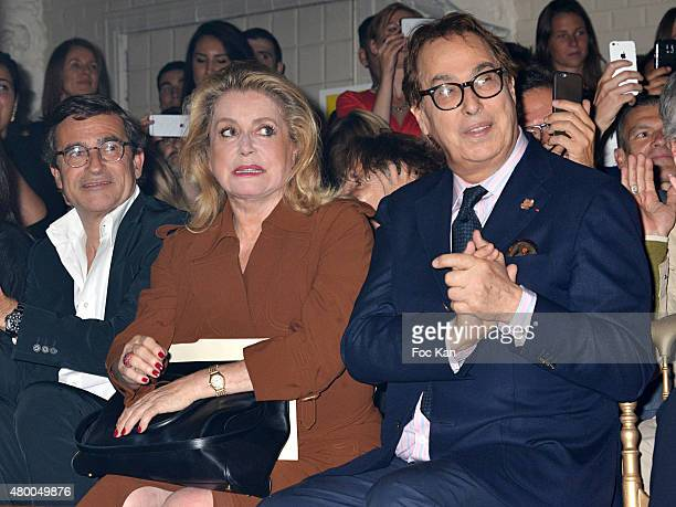 Catherine Deneuve and Gilles Dufour attend the JeanPaul Gaultier show as part of Paris Fashion Week Haute Couture Fall/Winter 2015/2016 at 325 rue...