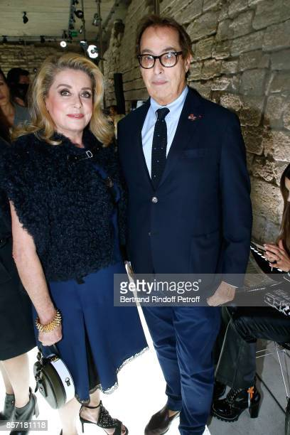 Catherine Deneuve and Gilles Dufour attend the Louis Vuitton show as part of the Paris Fashion Week Womenswear Spring/Summer 2018 on October 3 2017...