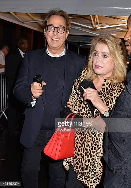 Catherine Deneuve and Gilles Dufour attend the Saint Laurent show as part of the Paris Fashion Week Womenswear Spring/Summer 2016 on October 5, 2015...