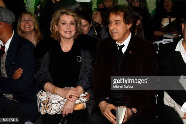 Catherine Deneuve and Gilles Dufour attends the Jean Paul Gaultier Fashion show, during Paris Fashion Week Fall-Winter 2008-2009 at JPG Show room on...