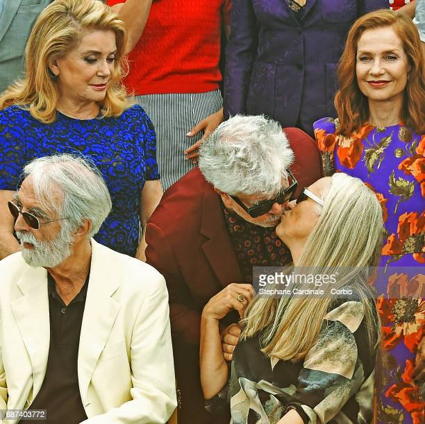 Catherine Deneuve and Isabelle Huppert look on as Pedro Almodovar kisses Jane Campion sitting next to Michael Haneke attends the 70th Anniversary...