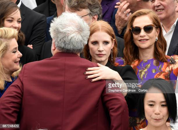 Catherine Deneuve and Isabelle Huppert look on as Pedro Almodovar speaks to Jessica Chastain during the 70th Anniversary photocall during the 70th...