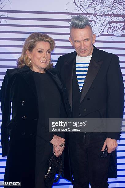 Catherine Deneuve and Jean Paul Gaultier attend the Jean Paul Gaultier Exhibition' Photocall at Grand Palais on March 30 2015 in Paris France