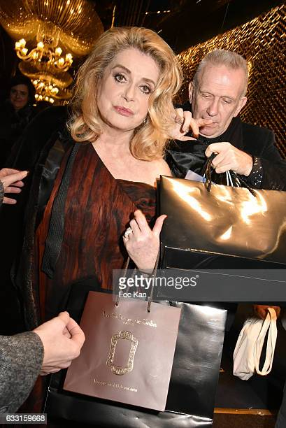 Catherine Deneuve and Jean Paul Gaultier leave Les Globes de Cristal Awards 11th Ceremony at Lido on January 30 2017 in Paris France