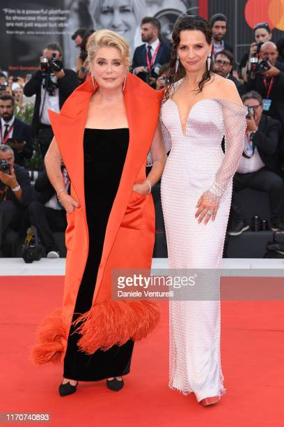 Catherine Deneuve and Juliette Binoche walk the red carpet ahead of the Opening Ceremony and the La Vérité screening during the 76th Venice Film...