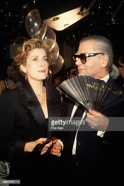 Catherine Deneuve and Karl Lagerfeld attend a fashion week Party at Les Bains Douches in the 1990s in Paris France