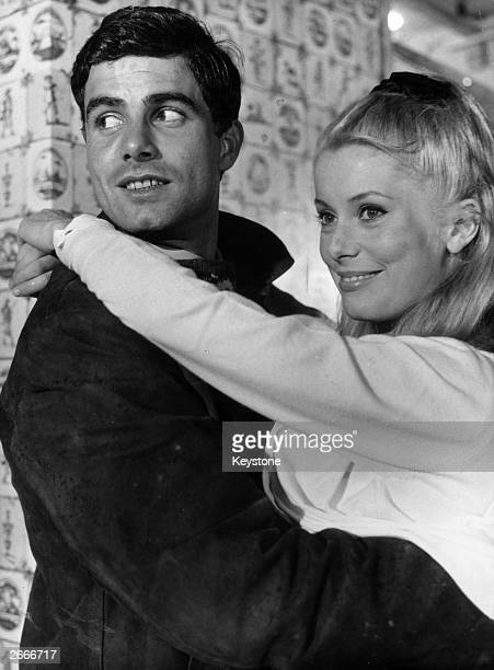 Catherine Deneuve and Nino Castelnuovo play the tragic lovers in Jacques Demy's musical masterpiece 'Les Parapluies de Cherbourg'