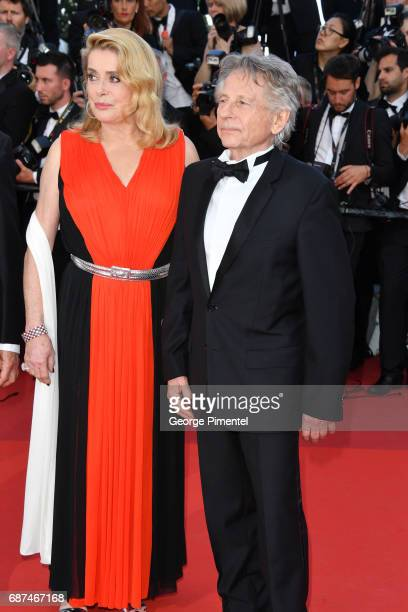 Catherine Deneuve and Roman Polanski attends the 70th Anniversary screening during the 70th annual Cannes Film Festival at Palais des Festivals on...