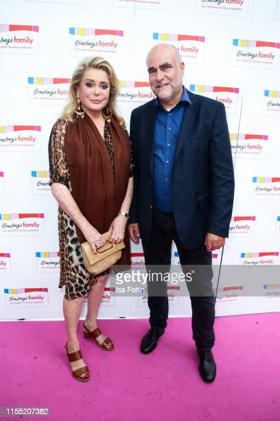 Catherine Deneuve and Stephan Ernsting during the Ernsting's family Fashion Show 2019 on July 11 2019 in Hamburg Germany