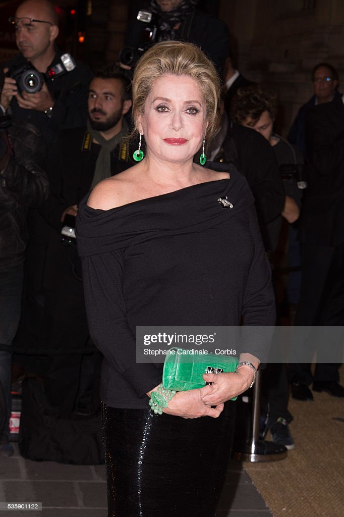 Catherine Deneuve arrives at a Ralph Lauren Collection Show and private dinner at Les Beaux-Arts de Paris on October 8, 2013 in Paris, France. On this occasion Ralph Lauren celebrates the restoration project and patron sponsorship of 'L'Ecole des Beaux-Arts'.