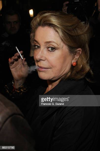 Catherine Deneuve arrives at the Yves Saint Laurent ReadytoWear A/W 2009 fashion show during Paris Fashion Week at Palais de Tokyo on March 9 2009 in...