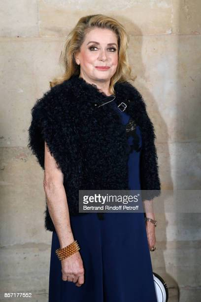 Catherine Deneuve attends the Louis Vuitton show as part of the Paris Fashion Week Womenswear Spring/Summer 2018 on October 3 2017 in Paris France