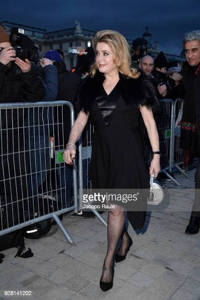 Catherine Deneuve attends the Louis Vuitton show as part of the Paris Fashion Week Womenswear Fall/Winter 2018/2019 on March 6 2018 in Paris France