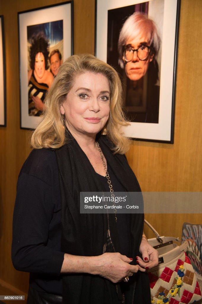 Catherine Deneuve attends the Simon Bocanegra and Philippe Morillon Exhibition, at la Galerie Du passage Pierre Passebon on October 18, 2017 in Paris, France.