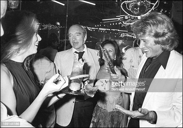 Catherine Deneuve Eddie Barclay his wife Daniele Poinsot and Johnny Hallyday celebrate Hallyday's 38th birthday at the Elysee Matignon night club in...