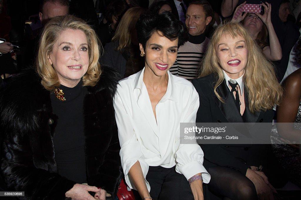 Catherine Deneuve, Farida Khelfa and Arielle Dombasle attend the Jean Paul Gaultier show as part of Paris Fashion Week Haute Couture Spring/Summer 2014, in Paris.