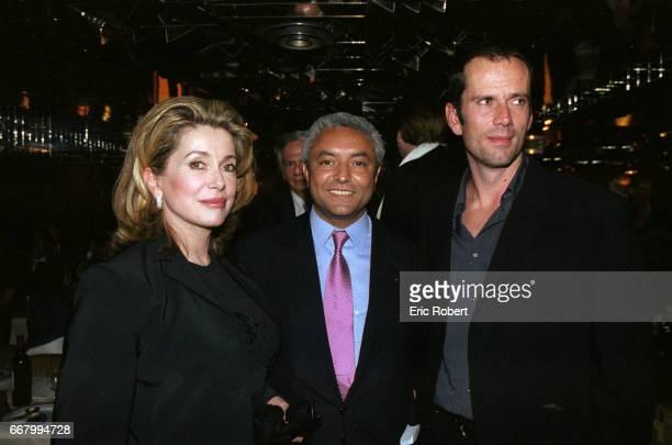 Catherine Deneuve, Francois Benaceur, and Christian Vadim attend a benefit party for the Association pour la Vie Espoir contre le Cancer in Paris....
