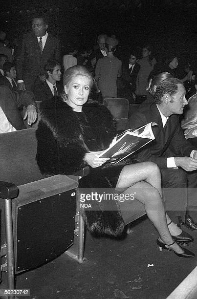Catherine Deneuve French actress and Gilles Dreyfus lawyer at a James Brown concert Paris Olympia 1967 HA107224