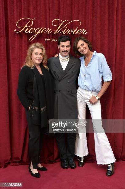 Catherine Deneuve Gherardo Felloni and Ines de la Fressange attend the Roger Vivier Presentation Spring/Summer 2019 during Paris Fashion Week on...