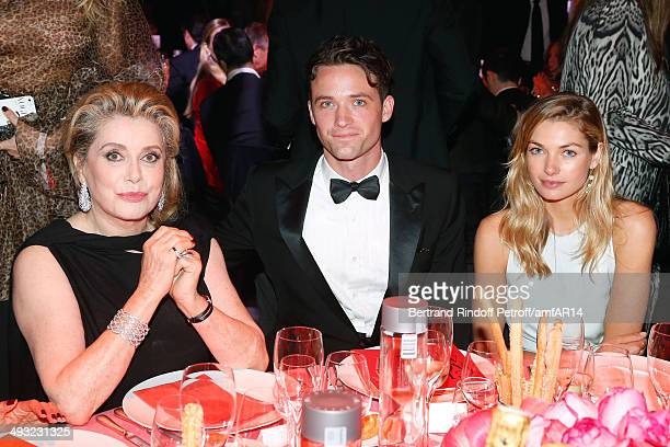 Catherine Deneuve, Louis-Marie de Castelbajac and Guest amfAR's 21st Cinema Against AIDS Gala Presented By WORLDVIEW, BOLD FILMS, And BVLGARI at...