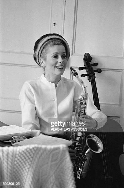 Catherine Deneuve Playing Saxo On The Set Of The Movie 'Les Demoiselles De Rochefort' Directed By Jacques Demy In RochefortFrance On June 9 1966