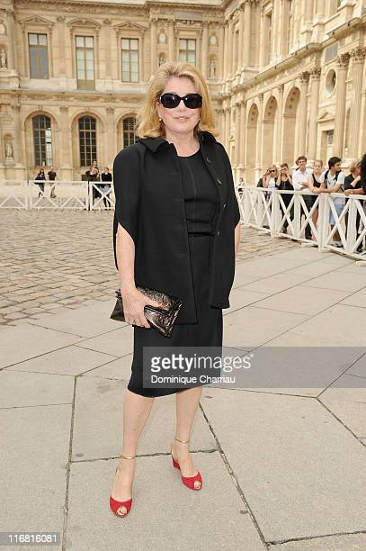 Catherine Deneuve poses as she arrives for the Louis Vuitton Pret a Porter show as part of the Paris Womenswear Fashion Week Spring/Summer 2010 at...