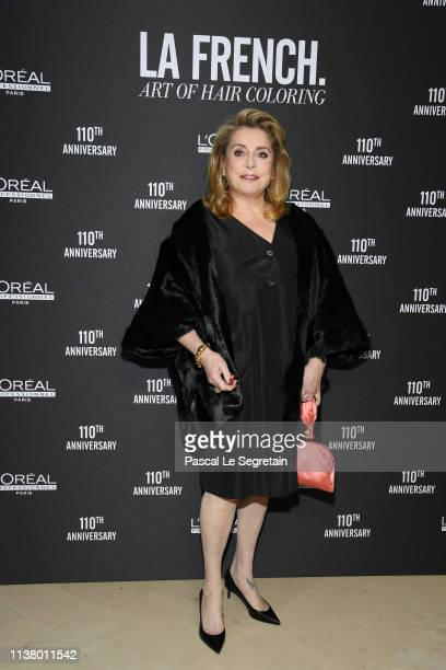 Catherine Deneuve poses at a photocall during the La FrenchArt Of Coloring 110th Anniversary of L'Oreal Professional At Carrousel Du Louvre on March...