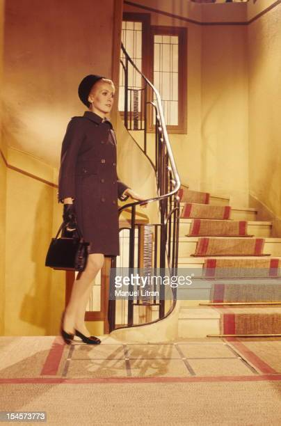 Catherine Deneuve up a staircase while filming a scene from the movie 'Beautiful Day' by Luis Bunuel