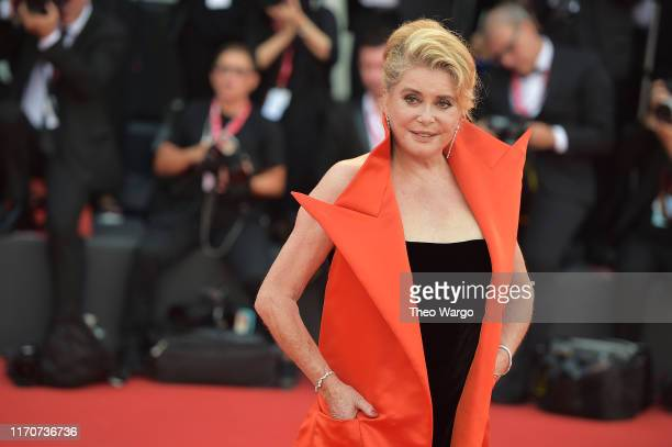 Catherine Deneuve walks the red carpet ahead of the Opening Ceremony and the La Vérité screening during the 76th Venice Film Festival at Sala Grande...
