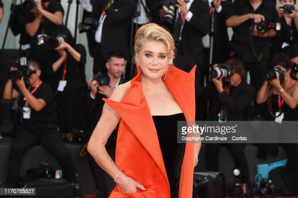 Catherine Deneuve walks the red carpet ahead of the opening ceremony during the 76th Venice Film Festival at Sala Casino on August 28 2019 in Venice...