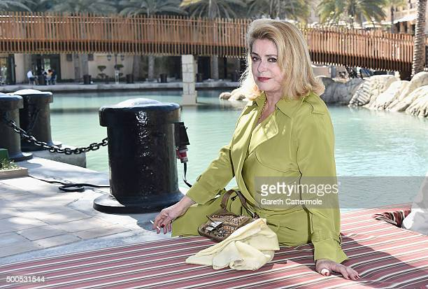Catherine Deneuve who receives a Lifetime Achievement award arrives ahead of a photocall during day one of the 12th annual Dubai International Film...