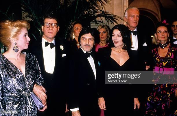 Catherine Deneuve Yves Siant Laurent Emmanuel Ungaro Anouk Aimee and Hubert de Givenchy attend a party 1990 in Paris France