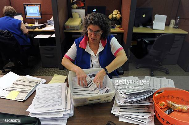 Catherine DeSmet a temporary election official with the Denver Elections Commission compiles applications for mailin ballots The commission will...