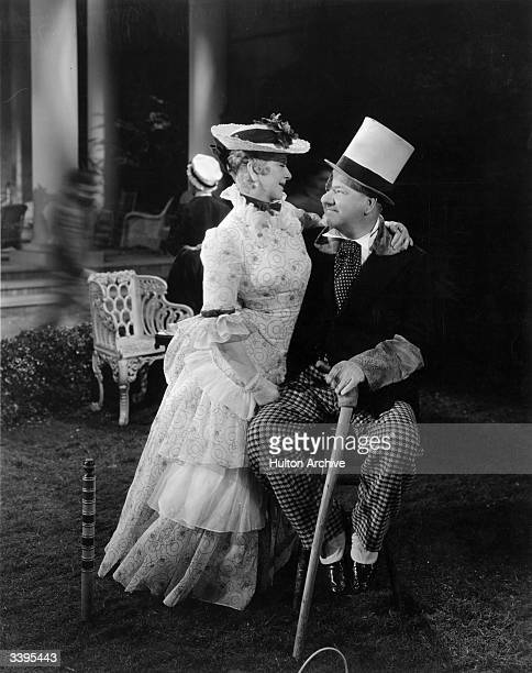 Catherine Doucet sits on the lap of comedian W C Fields in a scene from the film 'Poppy' directed by A Edward Sutherland for Paramount