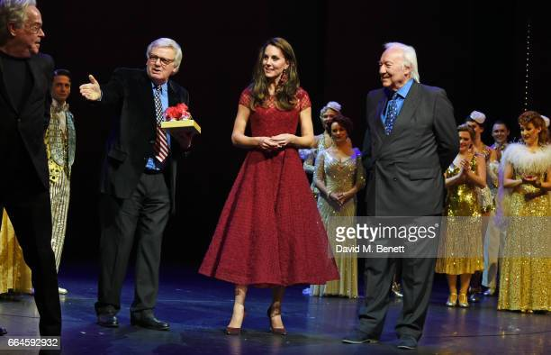 Catherine Duchess of Cambridge accepts a gift of tap shoes from producers Michael Linnet and Michael Grade during the Opening Night Royal Gala...