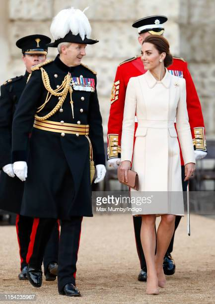 Catherine, Duchess of Cambridge, accompanied by Major General Ben Bathurst, attends the Household Division's 'Beating Retreat' at Horse Guards Parade...