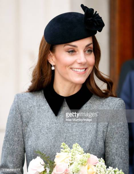 Catherine Duchess of Cambridge accompanies Queen Elizabeth II on a visit to King's College London to officially open Bush House the latest education...
