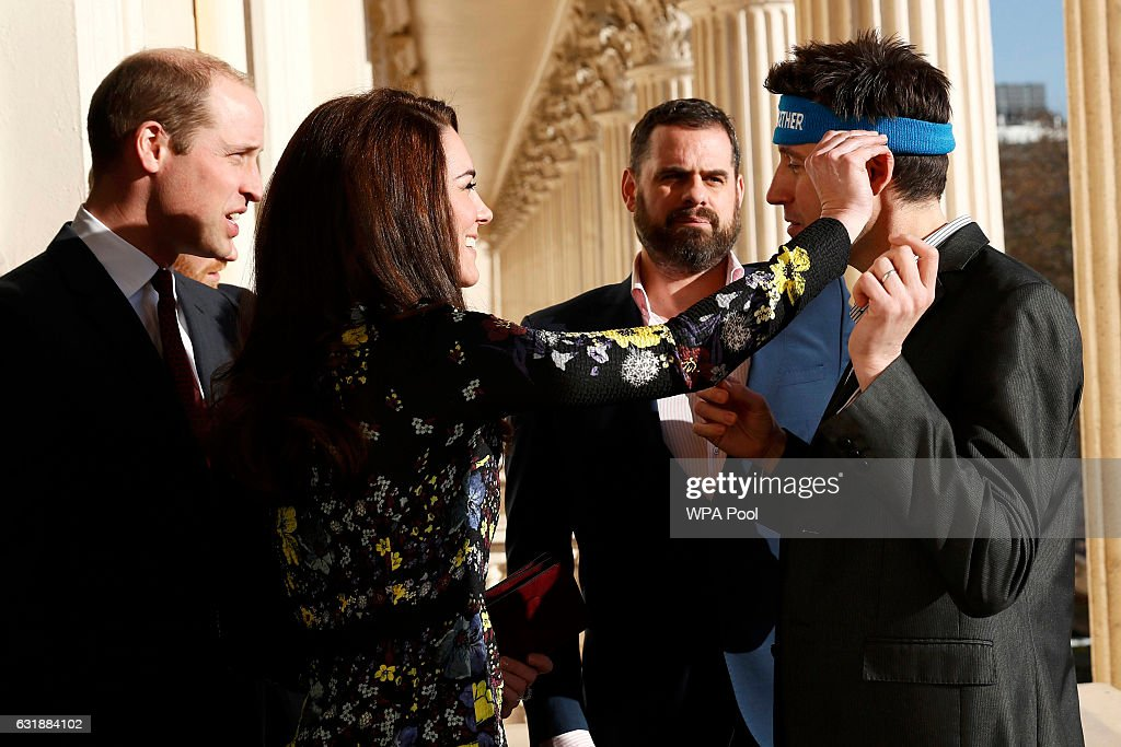 Catherine, Duchess Of Cambridge adjusts marathon runner Jon Salmon's headband as Prince William, Duke of Cambridge (L) and Steve Jackson look on during an event to announce plans for Heads Together ahead of the 2017 Virgin Money London Marathon at ICA on January 17, 2017 in London, England. Heads Together, Charity of the Year 2017, is led by The Duke & Duchess of Cambridge and Prince Harry in partnership with leading mental health charities.