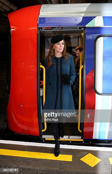 Catherine Duchess of Cambridge alights from a train as she makes an official visit to Baker Street Underground Station to mark 150th anniversary of...