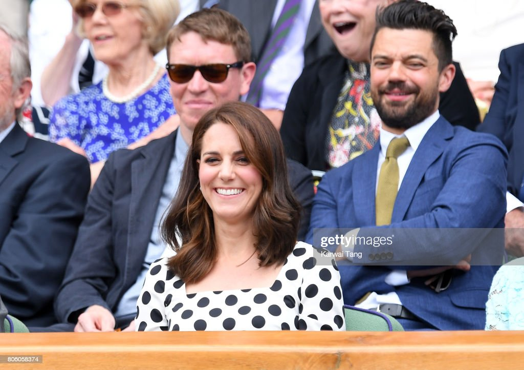 Catherine, Duchess of Cambridge (C) and actor Dominic Cooper (behind right) attend the opening day of Wimbledon 2017 on July 3, 2017 in London, England.
