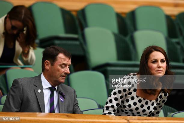 Catherine Duchess of Cambridge and AELTC Chairman Philip Brook look on from centre court on day one of the Wimbledon Lawn Tennis Championships at the...