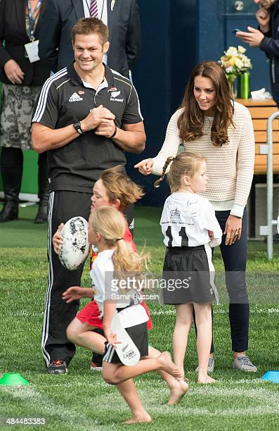 Catherine Duchess of Cambridge and All Blacks captain Richie McCaw watch a young players' Rugby tournament at Forsyth Barr Stadium on April 13 2014...