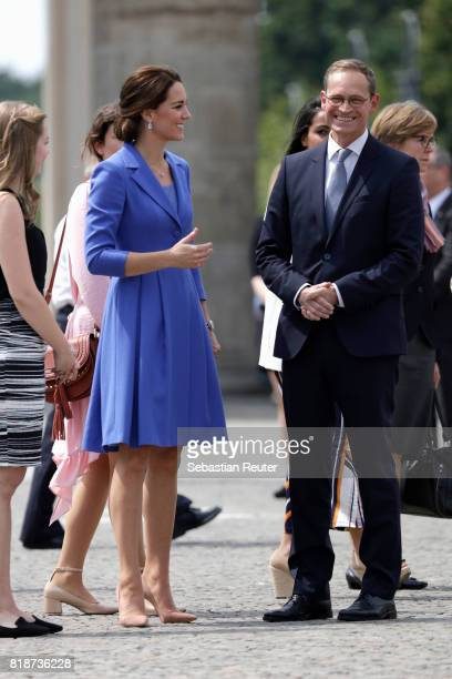 Catherine Duchess of Cambridge and Berlin Mayor Michael Mueller arrive at the Brandenburg Gate during an official visit to Poland and Germany on July...