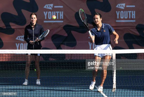 Catherine, Duchess of Cambridge and British US Open champions Emma Raducanu in action as they return to the LTA's National Tennis Centre for The...