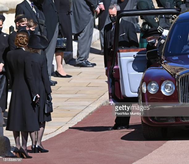 Catherine, Duchess of Cambridge and Camilla, Duchess of Cambridge look on as Queen Elizabeth II arrives to attend the funeral of Prince Philip, Duke...