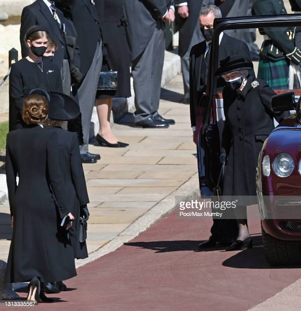 Catherine, Duchess of Cambridge and Camilla, Duchess of Cambridge curtsey to Queen Elizabeth II as she arrives to attend the funeral of Prince...