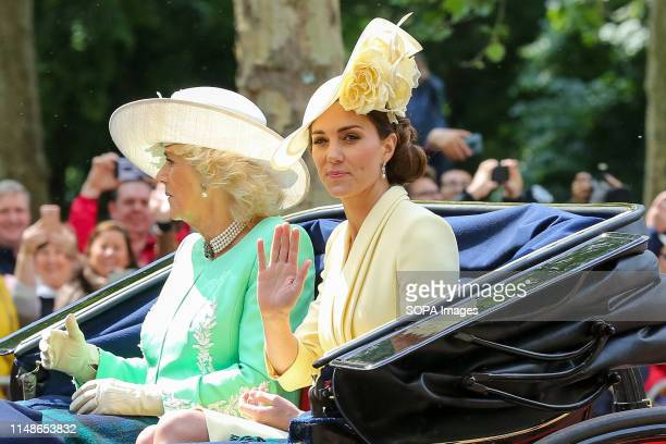 Catherine Duchess of Cambridge and Camilla Duchess of Cornwall are seen in a carriage on their way to the Horse Guards Parade during the Trooping the...
