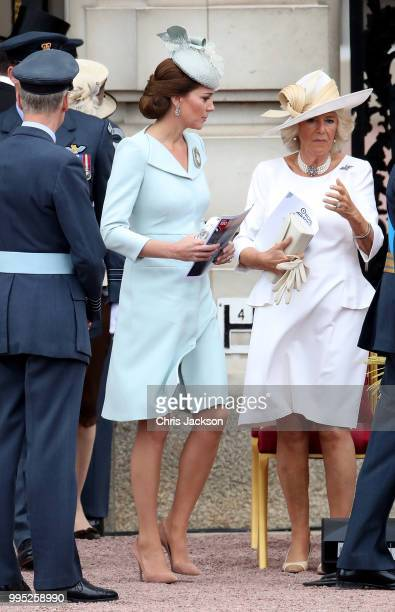 Catherine Duchess of Cambridge and Camilla Duchess of Cornwall during the RAF 100 ceremony at Buckingham Palace as members of the Royal Family attend...